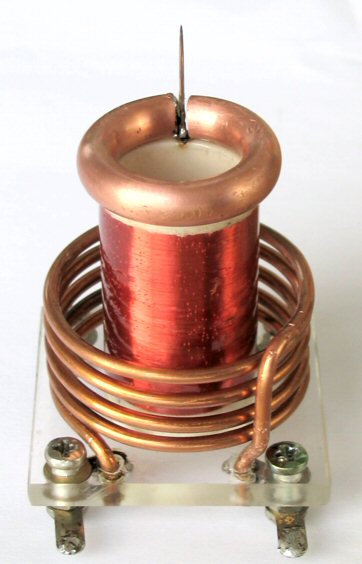 Tesla Battery Schematics besides Autodesk 123d Circuits Download also DGw0OTQtYXBwbGljYXRpb24tc2NoZW1hdGlj together with Designing Induction Heater Circuit in addition Bipolar Junction Transistors As Switches. on solid state tesla coil schematic